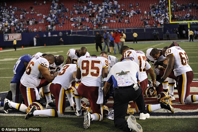 football players praying.jpg