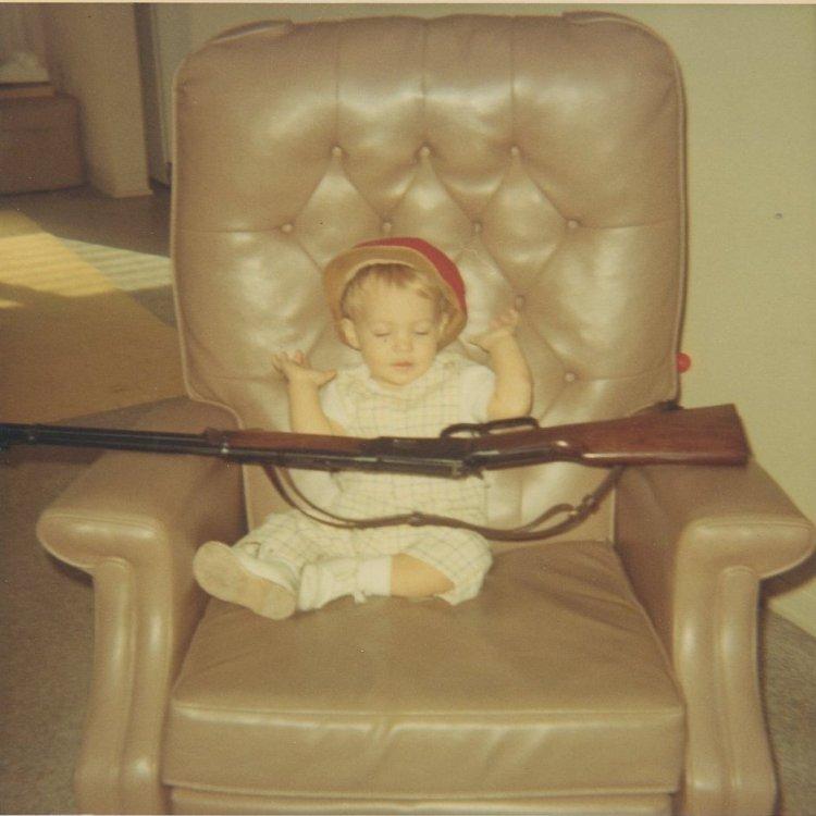 Bryan as a baby with gun.jpg