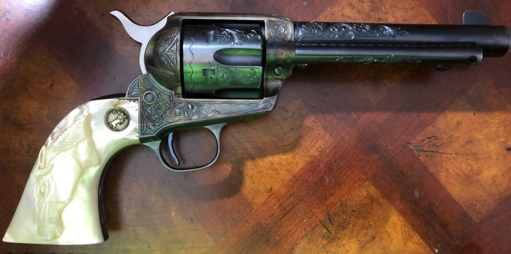 Rare-Colt-SAA-Pre-War-Post-War-gun-Factory-Glahn-Engraved-with-carved-pearl-grips-and-pictured-in-th_101099414_67834_B2E41FEA8DE3FC39.jpg