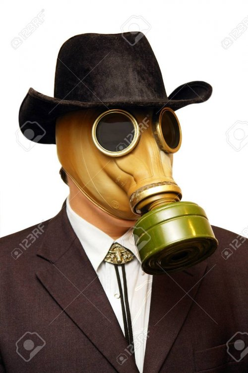 2186250-businessman-in-gas-mask-cowboy-hat-isolated-on-white-.jpg