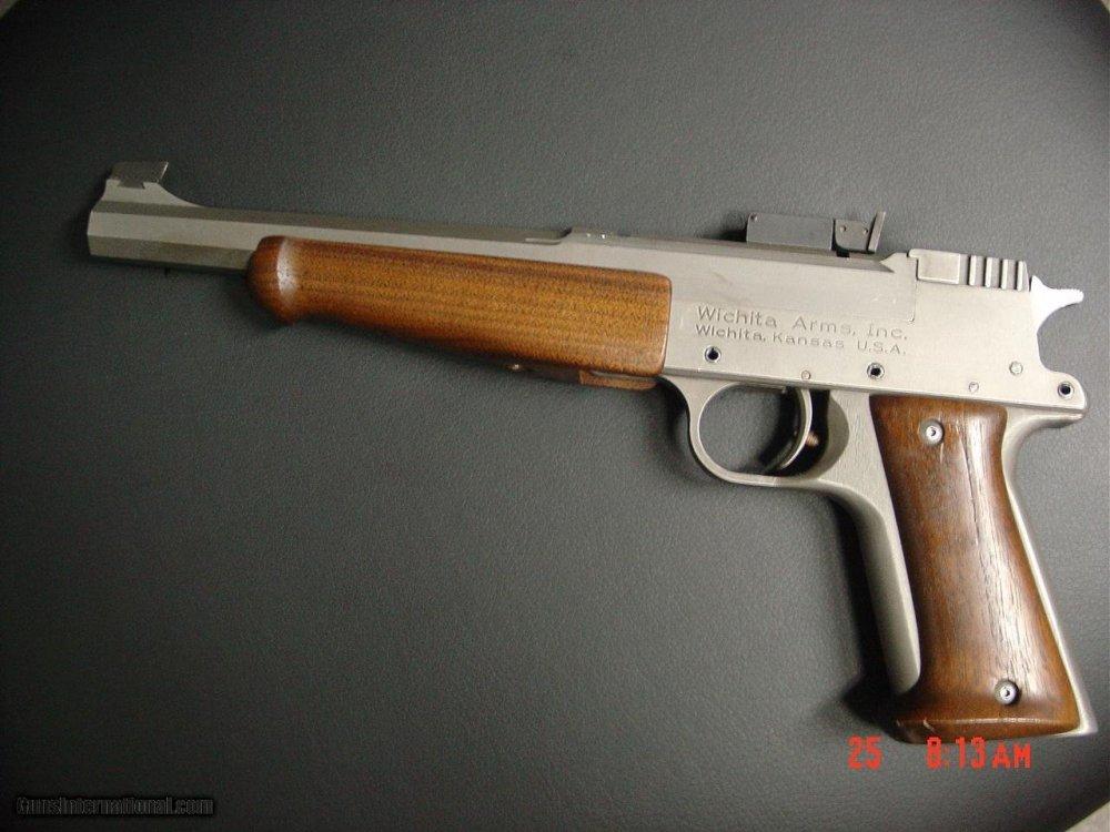Wichita-International-Pistol-3-barrel-set-10inch-barrels-7mm-Int-R-with-brass-and-die-32-HandR-mag-a_100835852_621_44A3D5D211F106DD.jpg