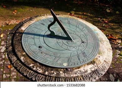 stone-metal-garden-sundial-on-260nw-1533682088.jpg
